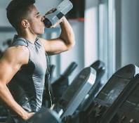 Gym with Man on Treadmill