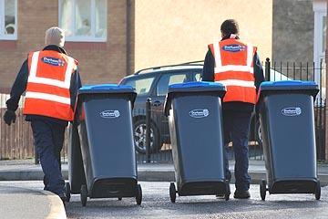 Two bin men with a wheelie bin