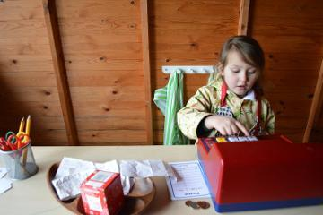 Child playing at desk