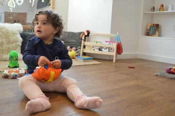 Child sitting on floor
