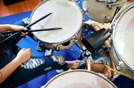 Close up images girl playing drum
