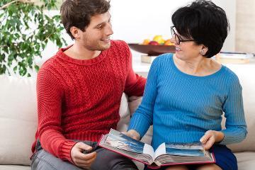 Man and woman looking at photo album