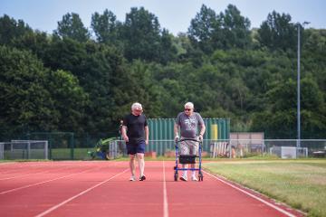 Two men on running track